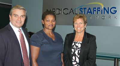 Local nurse, Eileen Moyton, LPN receives Medical Staffing Network/Kool 105.5 September Nurse of the Month Award. L to R are Medical Staffing Network CEO Bob Bunker, Nurse of the Month Winner Eileen Moyton and Medical Staffing Network CFO Ruth Wallace, at the Company's headquarters in Boca Raton, Florida.  (PRNewsFoto/Medical Staffing Network Healthcare, LLC)
