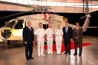 The Commonwealth of Australia, the U.S. Navy and Sikorsky July 23 formally celebrated delivery of the first MH-60R SEAHAWK helicopter to the U.S. Navy, the first step to transfer a mission-ready aircraft to the Royal Australian Navy in December 2013. From left to right: Dave Zack, director, Maritime Programs, Sikorsky Aircraft; Captain Michael Cerneck, commander, Defense Contract Management Agency Sikorsky Aircraft; Captain James Glass, H-60 Helicopters program manager, U.S. Navy; Commander Nyree Cornelius, MH-60R project team leader, Royal Australian Navy; Daniel Fankhauser, acting minister-counsellor, Defence Materiel Organisation, Embassy of Australia, Washington DC; Samir Mehta, president, Sikorsky Military Systems.  (PRNewsFoto/Sikorsky Aircraft Corporation)