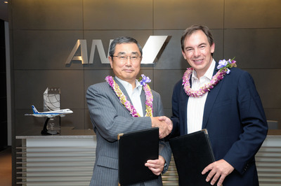 Shinichiro Ito (left), President and CEO of ANA, and Mark Dunkerley, President and CEO of Hawaiian Airlines, signed an agreement expanding the partnership between the two carriers to include code-sharing on passenger flights in Japan and Hawaii and mileage-earning benefits with their frequent flyer programs.  (PRNewsFoto/Hawaiian Airlines, Inc.)