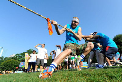 """Teams participate in tug-of-war during a field day event in Atlanta on Saturday, September 7, to kick-off Boys & Girls Clubs of America's """"Day for Kids"""" which invites adults to relive their childhood to help change the lives of kids in need. The nationwide initiative, supported by Lunchables, features hundreds of events at local Boys & Girls Clubs nationwide in September. (PRNewsFoto/Boys & Girls Clubs of America) (PRNewsFoto/BOYS & GIRLS CLUBS OF AMERICA)"""