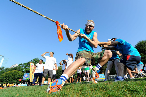Teams participate in tug-of-war during a field day event in Atlanta on Saturday, September 7, to kick-off Boys ...