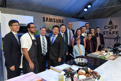 Pictured from left to right: Won-Kyong Kim, Executive Vice President, Samsung Electronics America, Chef Christopher Kostow, Chef The Restaurant at Meadowood, Ken Fisher, Chairman and CEO Fisher House Foundation, Gregory Lee, President and CEO Samsung Electronics North America, BK Yoon, President and CEO, Consumer Electronics, Samsung Electronics, Senator Cory Booker (D-NJ), Daniel Boulud, Chef DANIEL, Cathi McGuire and family, recipient of National Military Family Association Spouse Scholarship