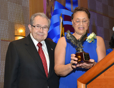 Jack Fitzgerald, founder and CEO of Fitzgerald Auto Malls, receives the NAACP's Presidential Humanitarian Award from Linda Plummer, President of the NAACP Montgomery County, Maryland branch.