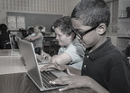 Cleveland Municipal School District students work on computers donated by KeyBank in 2013. Key is a strong supporter of CMSD and STEM (Science, Technology, Engineering and Math) education. (PRNewsFoto/KeyCorp)
