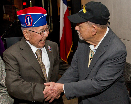 World War II veterans Tommie Okabayashi of Houston, left, and Robert Peiser of Harlingen, Texas reunited during the opening ceremony of the Congressional Gold Medal Exhibit at the Holocaust Museum Houston Thursday in honor of Japanese-Americans who ...