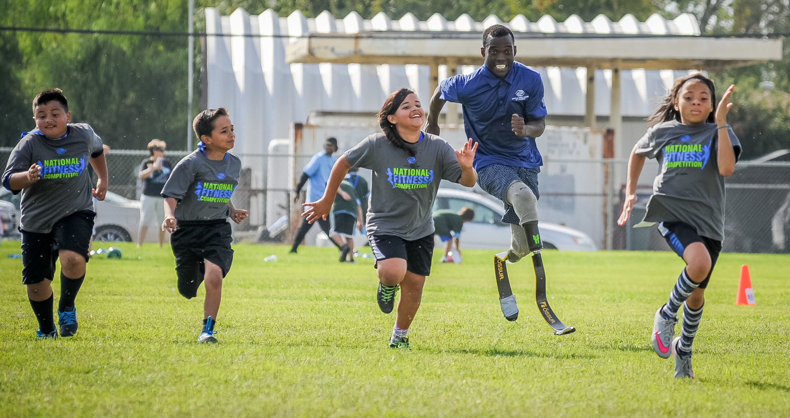 Paralympic athlete Blake Leeper races with Boys & Girls Club kids in Bakersfield, California during Boys & Girls Clubs of America and Nestle's National Fitness Competition.