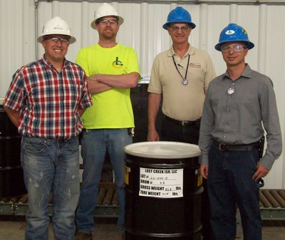 Ur-Energy plant employees with the barrel containing the one millionth pound of U308 drummed and shipped at the Lost Creek ISR uranium mine.