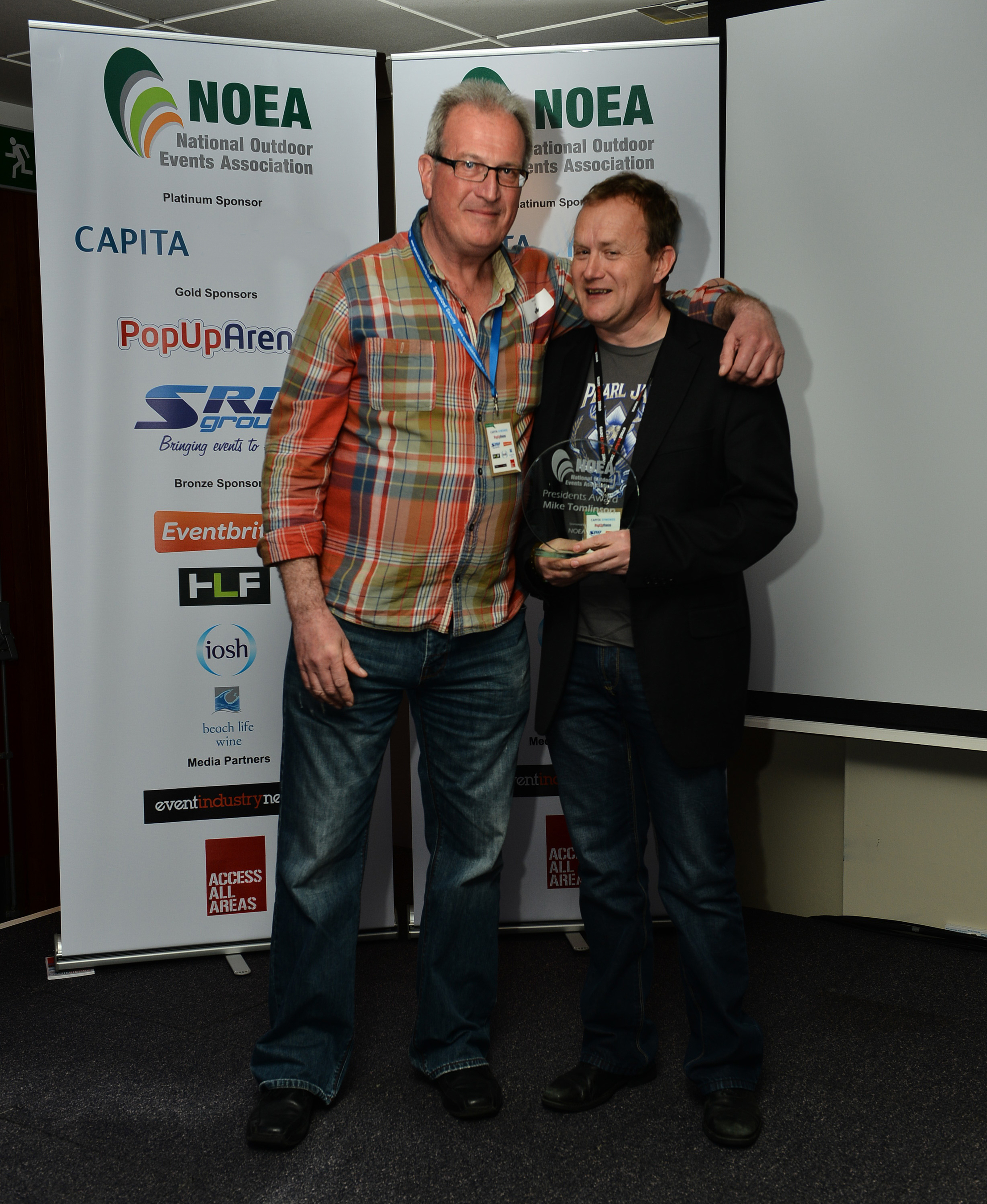 NOEA President Richard Limb presenting the Presidentâeuro(TM)s Award to Mike Tomlinson for outstanding achievement and contribution to the events industry at last yearâeuro(TM)s awards. (PRNewsFoto/NOEA)