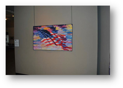 "Evocative quilt depiction of an embattled American flag, ""And Our Flag Was Still There!"", by Sacramento-area artist Melinda Bula.  (PRNewsFoto/National Quilt Museum)"