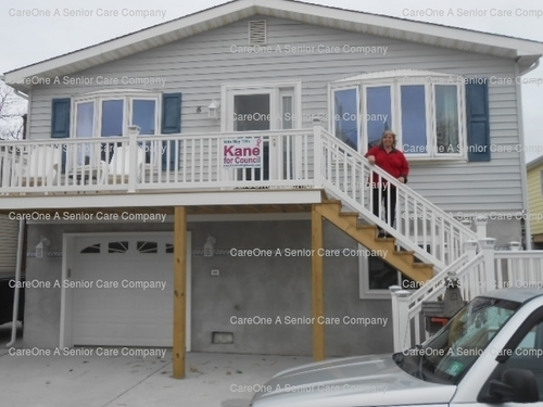 NJ resident Catherine Kane was able to rebuild her Atlantic Highlands home that was destroyed by Superstorm Sandy thanks to her employer, CareOne Management. (PRNewsFoto/CareOne Management)