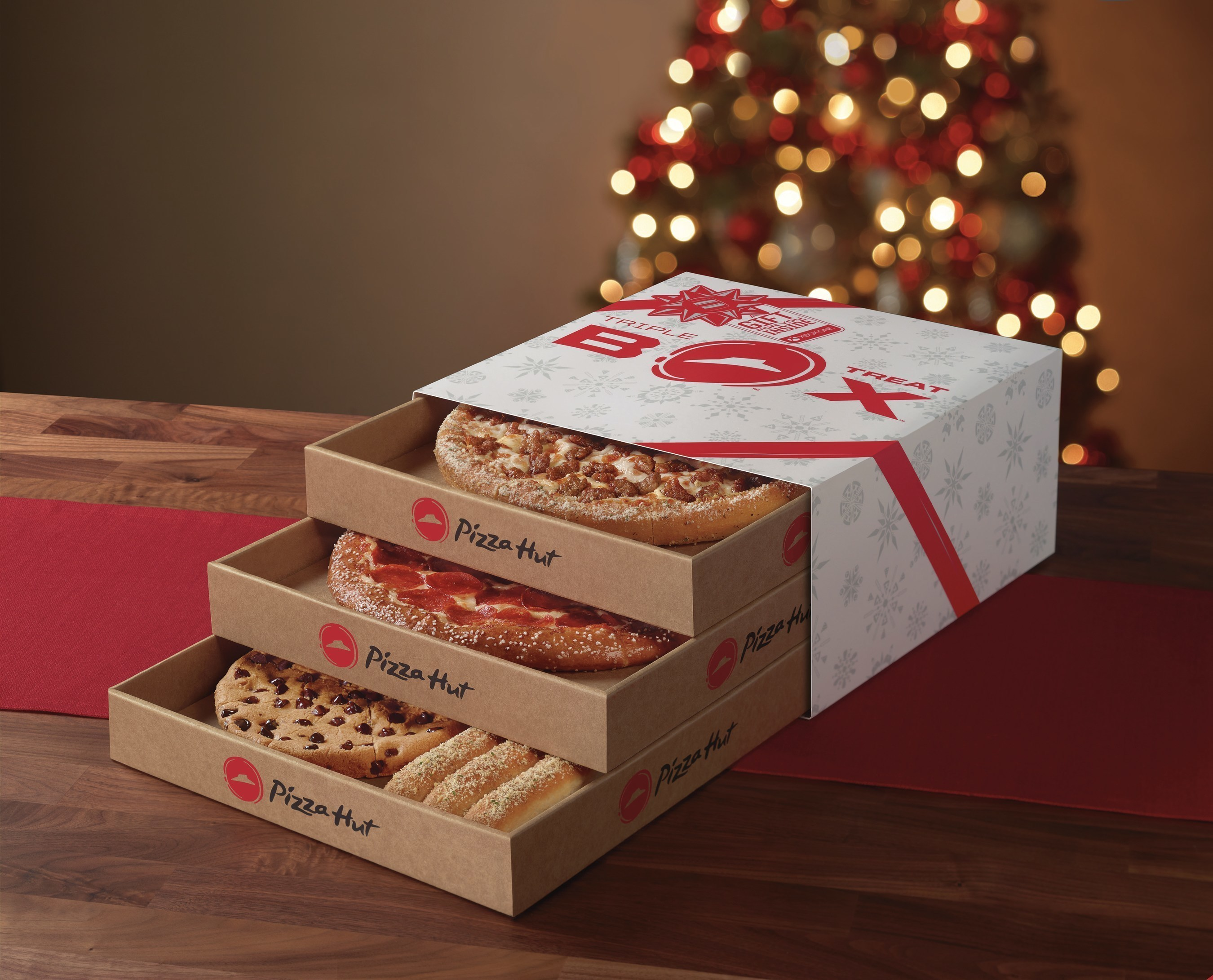 Perfect for get-togethers with friends and families looking to extend the fun of the holidays, the tri-level, holiday-themed Triple Treat Box from Pizza Hut will be available starting Nov. 7 for just $19.99 and includes two medium one-topping pizzas (available on Hand Tossed, Thin N' Crispy(R) or Pan), an order of breadsticks, a Hershey's Ultimate Chocolate Chip Cookie and a chance to win holiday fun for the whole family with an Xbox One S and custom Pizza Hut red controller.