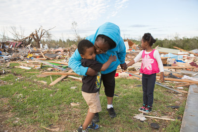 Destiny's Daycare Director Deborah Holmes comforts her Jaquan, 3 and Breanna, 5, after an April 2014 tornado destroyed their Louisville, Miss. child care center. Mississippi is one of 31 states that currently meet three child care emergency planning standards tracked by Save the Children annually. A new federal law means 19 lagging states will also need to meet the standards. Credit: Amie Vanderford/Save the Children.