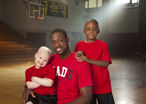 Miami Heat great Dwyane Wade, with St. Jude patients Cameron and Kaelyn, makes his debut in the Thanks and ...