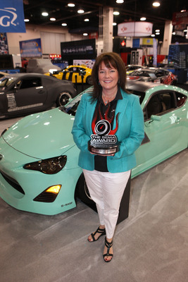 Jacie Dane, Scion Corporate Manager with a 2012 SEMA Award for the Scion FR-S named Hottest Sport Compact Car.  (PRNewsFoto/The SEMA Show)