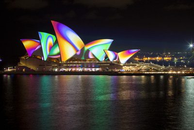 Sydney, ranked by Travel + Leisure as one of the Top Ten Cities Overall, lights the sails of the Opera House during Vivid Sydney Festival in June.  (PRNewsFoto/Tourism Australia)