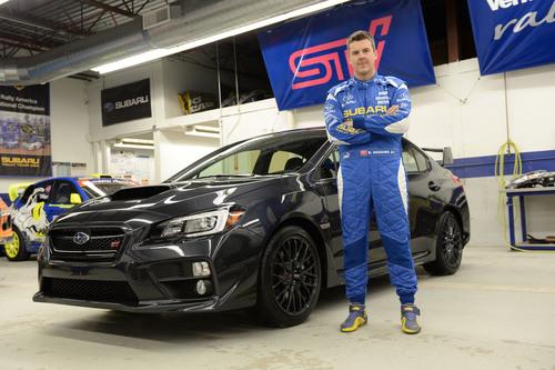 Defending Rally America Champion David Higgins and the 2015 WRX STI.  (PRNewsFoto/Subaru of America, Inc.)