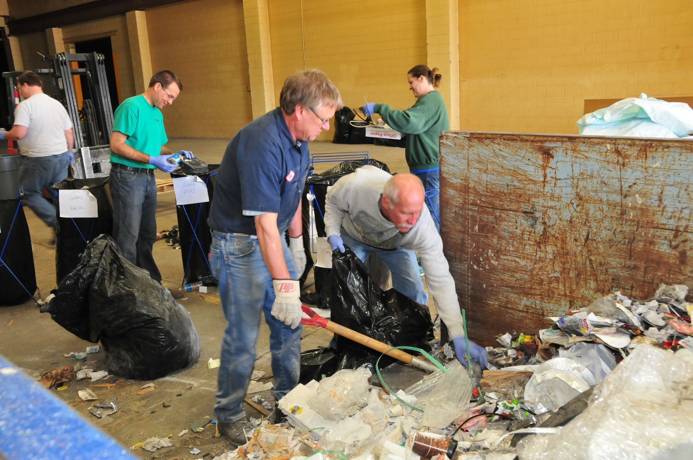 Curries employees participate in a dumpster dive to find out how they can manage their waste more responsibly.