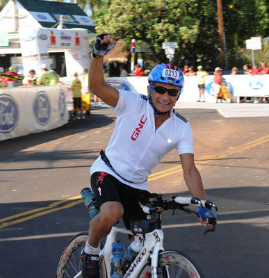Dr. Joseph C. Maroon, 73, Chairman of the GNC Medical Advisory Board, trains for his 5th Ironman World Championship in Kona, Hawaii.  (PRNewsFoto/GNC)