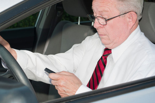 Survey says mature drivers catching up to phone-obsessed youth.  (PRNewsFoto/State Farm)