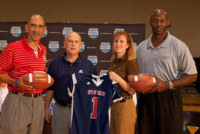 Gary Barfield (Russell Athletic EVP), Coach Tony Dungy (All-Pro Dad & Former NFL Coach), Orlando Mayor Buddy Dyer and City of Orlando Youth Football League representatives Lisa Early and Clifford Charlton accepting the youth football donation at Memorial Middle School in Orlando, Florida.  (PRNewsFoto/Russell Athletic)