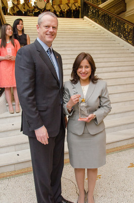 """Governor Charlie Baker with """"29 Who Shine"""" honoree and Bunker Hill Community College graduate, Yamileth Lopez."""