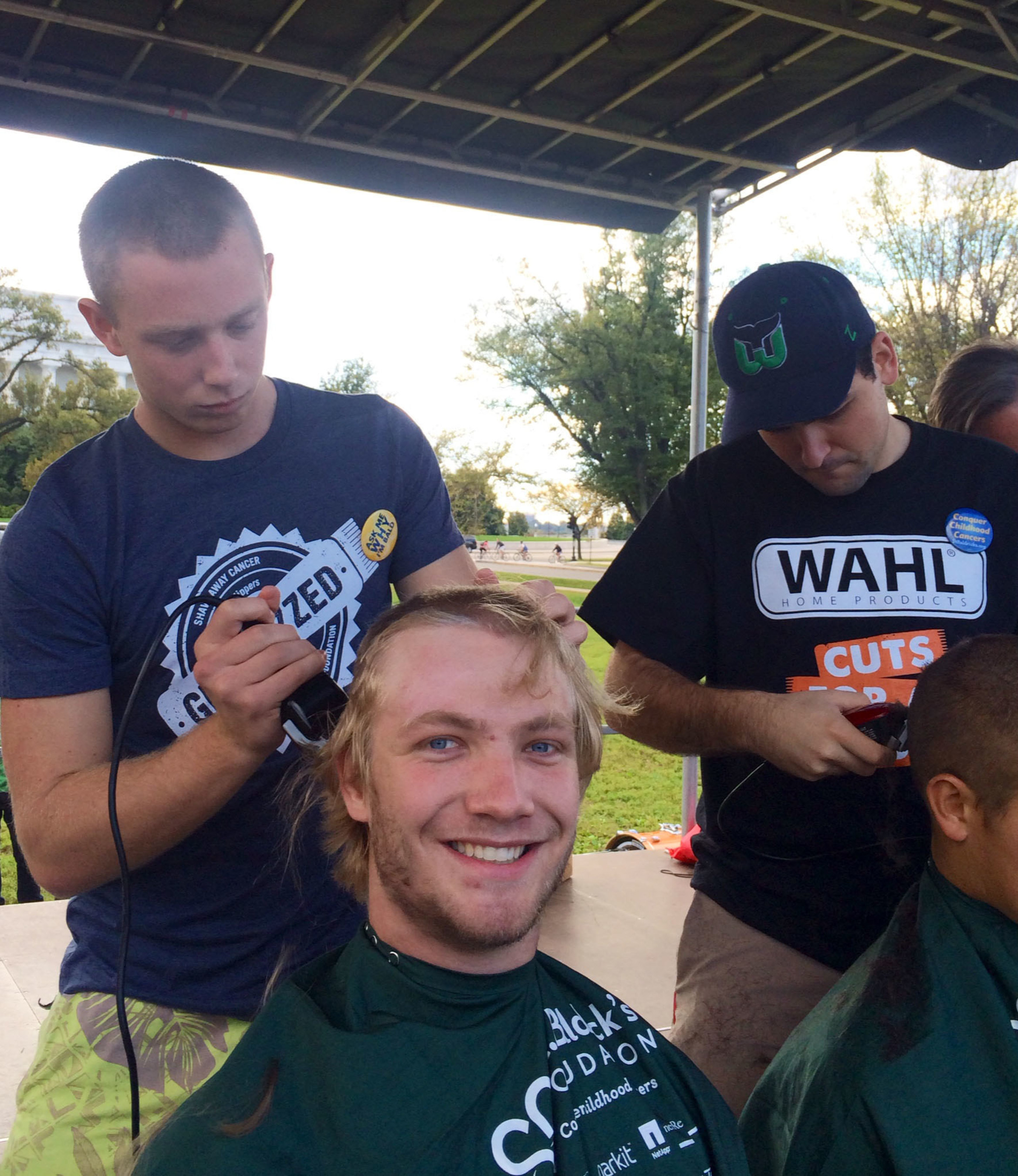 Washington DC students have their heads shaved at a Wahl Cuts for a Cause event to raise money for childhood cancer research.