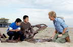 Children from the Santa Monica Boulevard Community Charter School get up close and personal with an Albertosaurus on Santa Monica Beach for the launch of the Travel Alberta summer campaign.  (PRNewsFoto/Travel Alberta)