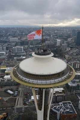 Seattle museums and hotels raise Space Needle flag to draw visitors.