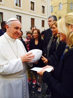 Pope Francis accepts a football from Linda Del Rio, signed by all of the Denver Broncos, last October in Vatican City (PRNewsFoto/FOCUS, the Fellowship of Cath...)