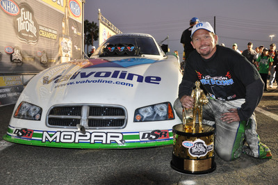 Jack Beckman drove his Mopar powered Dodge Charger R/T  to his first NHRA Championship and a second consecutive Funny Car World Championship for Mopar and Don Schumacher Racing at the season finale in Pomona, California.  (PRNewsFoto/Chrysler Group LLC)