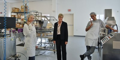 Udder Delight owner, Kristine Shoberg (center) is shown with employees, Charlotte Ruth (left) and Daniel Morales (right) in her new facility, where the team manufactures natural skincare products.