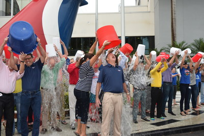 In this photo provided by Carnival Cruise Lines, Yvette Sanchez, left, pours ice water down the back of Carnival Cruise Lines' CEO Gerry Cahill, second from left, as he joined more than three dozen other Carnival employees for the ALS Ice Bucket Challenge Thursday, Aug. 14, 2014, at the company's headquarters in Miami. The challenge is aimed at raising funds to fight ALS, also known as Lou Gehrig's disease. In conjunction with the event, Cahill announced Carnival was making a $100,000 donation to the ALS Association. (PRNewsFoto/Carnival Cruise Lines)