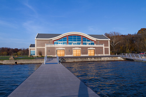 CULVER, Ind. - Culver Academies' new 24,000 square-feet White-DeVries Rowing Center sits on the northeast side of Lake Maxinkuckee. The two-story facility includes two eight-seat rowing tanks for year-round practice, a weight room, a three-bay rowing shell storage area, and an upstairs lounge that opens on to a balcony to watch rowing competitions and other lakeside events. The building was dedicated on Oct. 5. Culver Academies offers boys and girls rowing in the fall and spring.  (PRNewsFoto/Culver Academies)