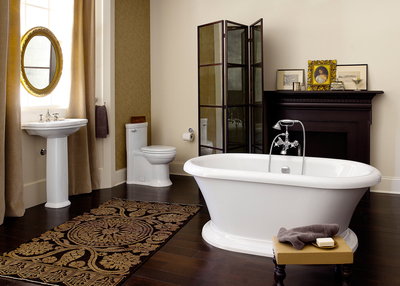 Stately, sculptural and well-proportioned, the DXV St. George suite's freestanding tub, pedestal sink and one-piece toilet, all in canvas white, pay tribute to the decorative details perfected at the turn of last century, the height of the Classic movement. Faucets, floor-mounted tub filler and accessories in platinum nickel from the DXV Landfair collection, another Classic movement offering, add a touch of elegantly refined ornamentation.  (PRNewsFoto/American Standard Brands)