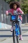"In Columbia Pictures' ""Annie,"" in theaters December 19, Annie (Quvenzhane Wallis) rides a Citi Bike(R) through the city. Starting Monday, New Yorkers will have the chance to ride themed, red ""Annie"" bikes in celebration of the film, in theaters December 19th."