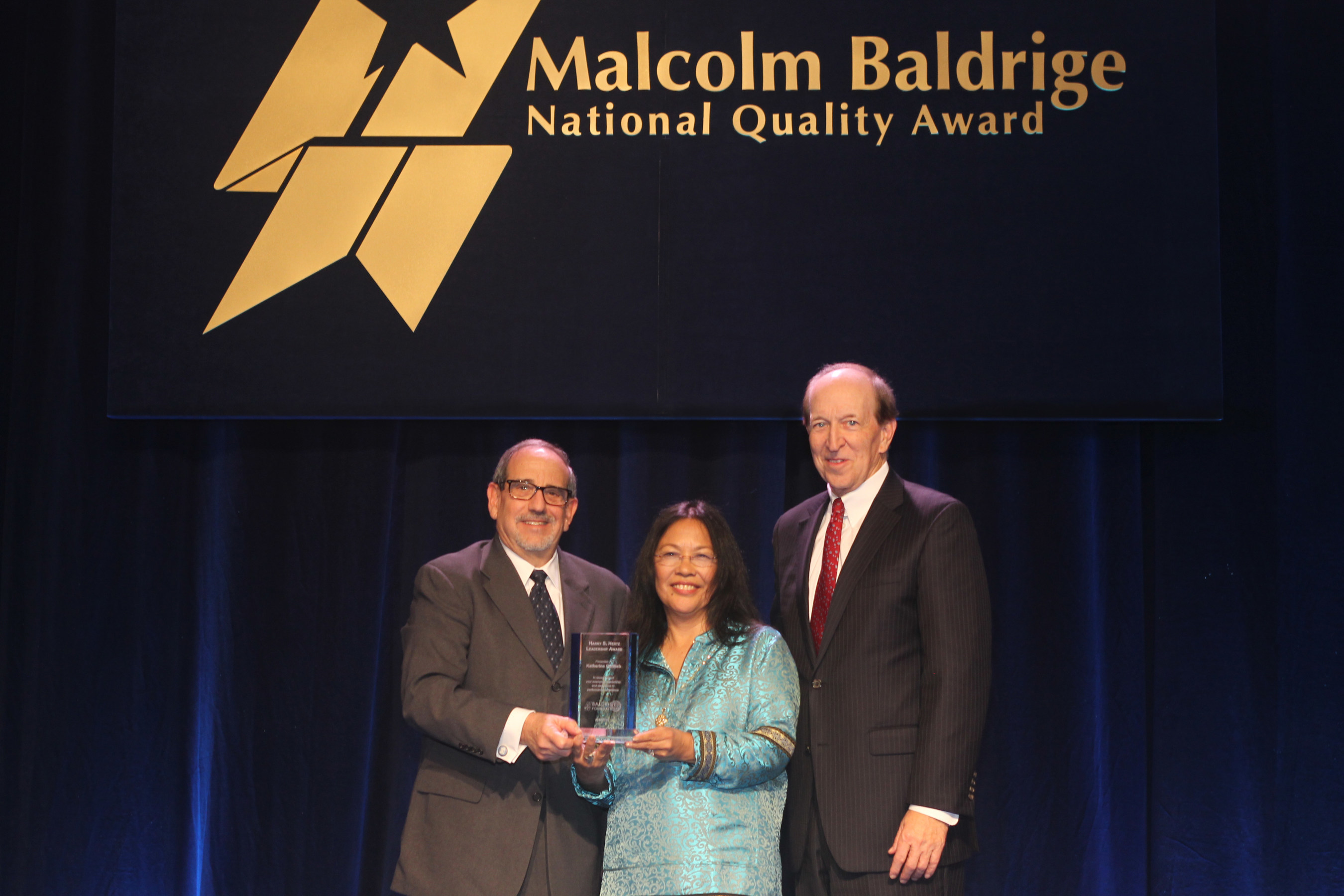(Left-Right) 2013 HSHLA Recipient and Baldrige Performance Excellence Program Director Emeritus Harry S. Hertz, 2015 HSHLA Recipient and Southcentral Foundation President/CEO Dr. Katherine Gottlieb and Baldrige Foundation Chair Dr. P. George Benson