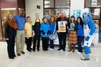 Dallas Mavericks' Mascot Champ poses with Mesquite High School staff at pep rally to promote its new Breakfast Breaks school breakfast program.