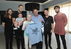 Hamish Dodds, center, President and CEO of Hard Rock International, and Wayne Sermon, Dan Reynolds, Ben McKee and Daniel Platzman, left to right, of Imagine Dragons, meet with Christian Smith, 4, of Dewey, Okla., and Kate Pierson, 13, of West Jordan, Utah, who have benefitted from the Tyler Robinson Foundation, at Hard Rock Hotel Riviera Maya in Mexico, Tuesday, Jan. 20, 2015, as part of the launch of Hard Rock's Imagine Dragons Signature Series T-shirt and pin. A portion of the retail price from sales of the merchandise will benefit the foundation supporting families affected by pediatric cancer. (Photo by Diane Bondareff/Invision for Hard Rock International/AP Images)