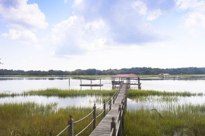The 3.83-acre property features expansive views of the Bohicket Creek and a deep water dock with direct Atlantic Ocean access
