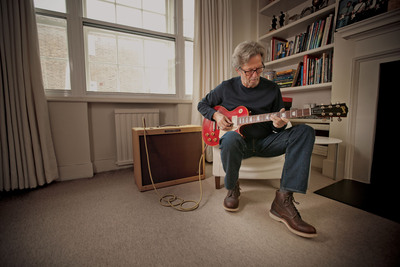 Eric Clapton playing 'Lucy' at home in London, during an exclusive interview with Guitar Center. The limited-edition collection of five Eric Clapton tribute, replica and signature guitars will be sold in North America exclusively at Guitar Center locations and online at GuitarCenter.com beginning Mach 21, 2013.  (PRNewsFoto/Guitar Center)