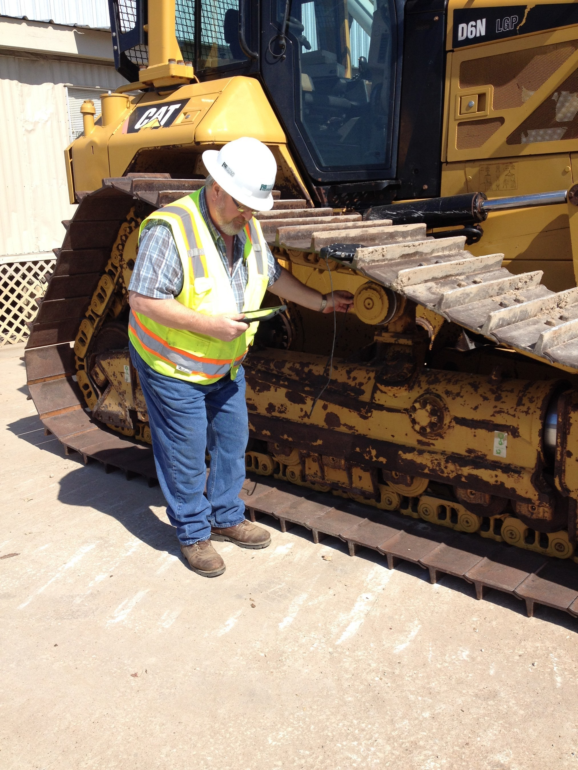 An equipment manager with Remedial Construction Services uses Modustri's HDE Suite, a mobile technology platform that simplifies field inspections of heavy duty construction equipment.