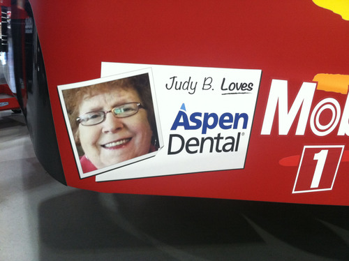 Judy Berryhill, a patient at the Clarksville, TN Aspen Dental practice, will have her winning smile featured on the tail of Ryan Newman's No. 39 Quicken Chevrolet at the Pure Michigan 400 NASCAR Sprint Cup Series race at Michigan International Speedway in Brooklyn on Sunday, August 18.  (PRNewsFoto/Aspen Dental)