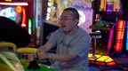 College of DuPage graduate and Autismerica member Josh Romaniak enjoys a video game at a recent club outing to Round1 Arcade in Stratford Square Mall.