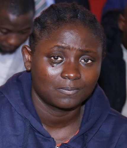 One of the deportee's sheds tears after receiving her own portion of the N10,000,000 ($33,000) gift presented to the group after they came to The Synagogue, Church Of All Nations to seek refuge. They are the fourth group of deportees who have received help from the church in 2016. (PRNewsFoto/Emmanuel TV)