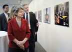Irina Bokova, Director General of UNESCO, and Steve Bishop, Group President of P&G's Global Feminine Care Division, tour photo exhibition from their girls' literacy programme in Senegal