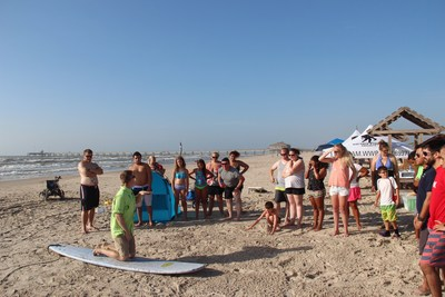With the help of surf clinic instructors, wounded warriors and family members rode the waves on the beaches of Corpus Christi.