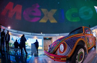 """The famous """"Vochol"""" âeuro"""" a Volkswagen Beetle decorated with more than two million beads is on display at the exhibition (PRNewsFoto/Mexico Tourism Board)"""