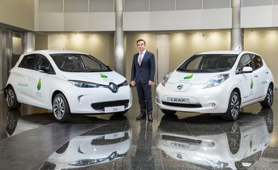 Renault-Nissan Chairman & CEO Carlos Ghosn with Renault ZOE and Nissan LEAF. Photo credit: Renault-Nissan Alliance. (PRNewsFoto/Renault-Nissan Alliance)