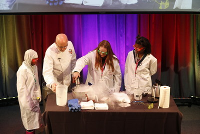 Former White House Executive Pastry Chef Bill Yosses demonstrates the science behind chocolate mousse at Covestro's first greenlight for girls Day at Carnegie Science Center.