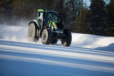 The new world record for fastest tractor was achieved when Nokian Tyres and Valtra combined their northern expertise. The new amazing record was set on a snowy and icy road in Finnish Lapland. Multiple World Rally Champion Juha Kankkunen kept his head cool and drove the machine at a speed of 130.165 km/h (80.88mph). Breaking the record was made possible by the world's first winter tyre for tractors, the Nokian Hakkapeliitta TRI.More: www.nokiantyres.com/FastestTractor2015